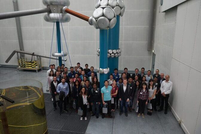 Group photo in a high voltage hall